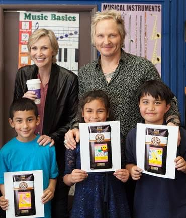 Jane Lynch and Matt Sorum with kids who designed artwork for limited edition Adopt the Arts coffee