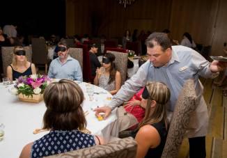 Guests at Dine in the Dark: A Sensory Lunch at Bacchanal Buffet. Credit Erik Kabik