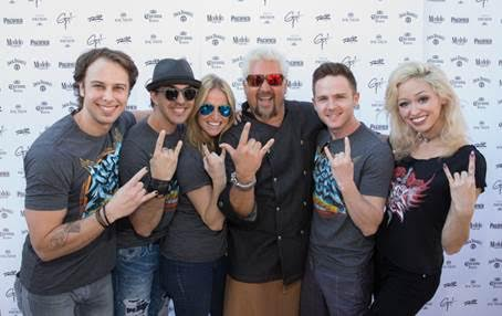 Guy Fieri with the cast of Rock of Ages. Credit- Erik Kabik