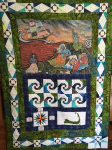 This quilt was made with a panel designed by June Herold of Quiltish of Cape Cod as part of the mermaid challenge in 2015. June provided each of the mermaids with the panel and fabrics and we designed a quilt with them.