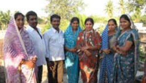 A jopyful pastor and wife with five newly baptized believers