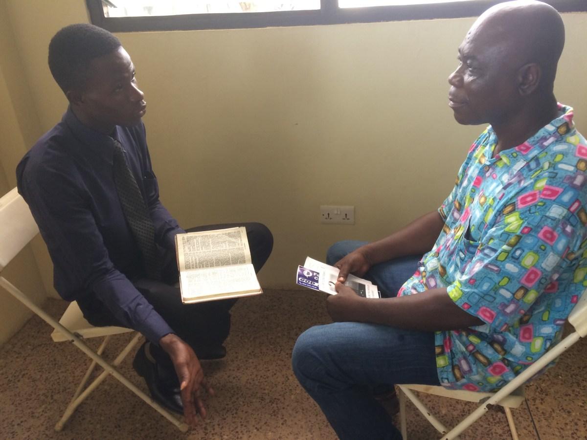 Michael preaching to Akwasi