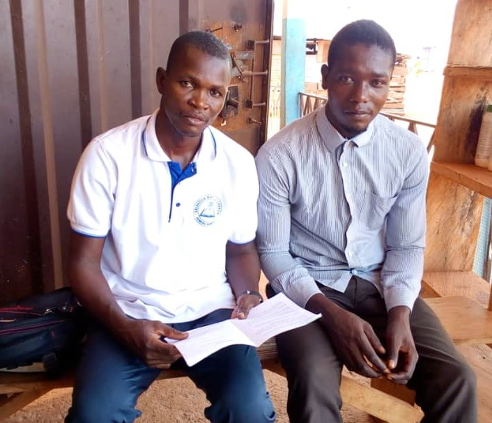 A pastor (left) with a street preacher (right)