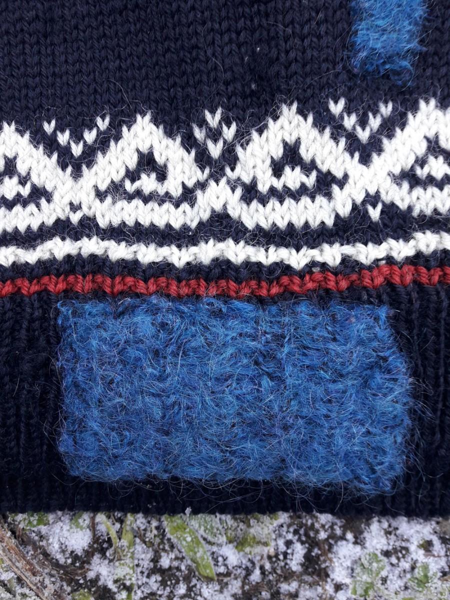 Morven Gregor, detail of felted patch on Norwegian jumper