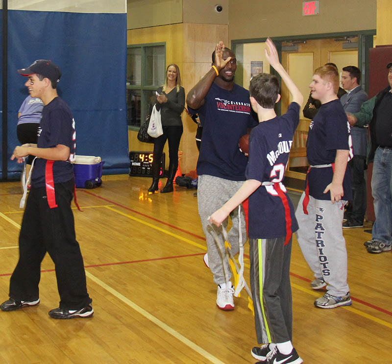 Patriots safety Devin McCourty led approximately 30 members of the Y's Integration Initiative through a variety of football-themed stretches and drills at Invensys Foxboro branch of the Hockomock Area YMCA on Monday, Nov. 10.