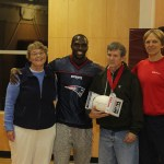 Patriots safety Devin McCourty, center, presented Bridgewater resident Mark Young, right, with the Patriots Difference Maker of the Week award for Special Needs Volunteerism at the Hockomock Area YMCA in Foxborough on Monday, Nov. 10.