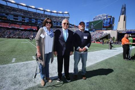 New England Patriots Chairman and CEO Robert Kraft (middle) visits with Foxborough High School football coach Jack Martinelli (right) and Martinelli's wife, Joanne, on the Patriots sideline prior to kickoff of the Patriots' Week 3 game vs. the Jacksonville Jaguars at Gillette Stadium on Sunday, Sept. 27. Kraft called to congratulate Jack shortly after the coach received the New England Patriots High School Coach of the Week award on Sept. 22 in recognition of his 250th career win, which he earned in a thrilling, 17-15 victory over King Philip on Sept. 17. To celebrate the accomplishment, Kraft invited Jack and Joanne to Sunday's game. The Martinellis attended Kraft's pregame reception inside Gillette Stadium before heading to the Patriots sideline to watch the team warm-up prior to kickoff. Following the field visit, Jack and Joanne enjoyed the Patriots' 51-17 win from club seats, courtesy of the Kraft family. As part of the coach of the week award, the New England Patriots Charitable Foundation will donate $1,000 to the Foxborough High School football program in Jack Martinelli's name. (Photo courtesy of the New England Patriots / David Silverman)
