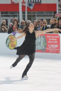 Taylor Rae Rocco performs at Sunday's Finale on Ice figure skating show at Patriot Place's Winter Skate. Proceeds from the event, which marked the end of the 2015-2016 ice skating season at the outdoor rink, benefit the Hockomock Area YMCA and Cradles to Crayons.