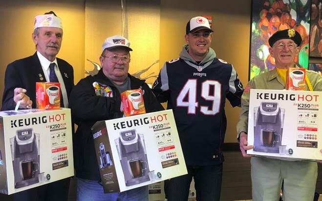 Patriots Long Snapper Joe Cardona honored local veterans from Foxboro Veterans of Foreign Wars Post 2626, including Commander Warren Wright (left), at the Patriot Place Dunkin' on Monday, November 12.