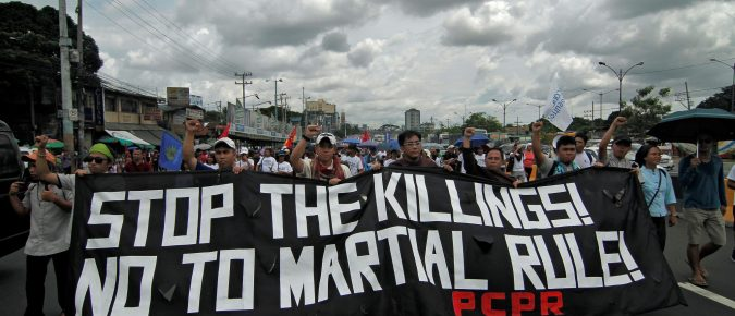 Protesters carry anti-martial law banners as they gather outside the House of Representatives in Manila in July: only in Syria and Iraq have more journalists been killed. Photo: AFP/Vincent Go
