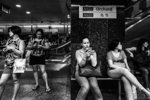 Female migrant workers waits for the train in Orchard, Singapore. Orchard is full of migrants every Sunday. Photo: Xyza Bacani