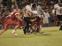 Junior Charlie Mann (No. 23) breaks a tackle. (Photo: Bob Morrison, Bonnie Briar, LLC)