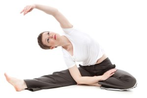 Woman stretching her arms and her right legs