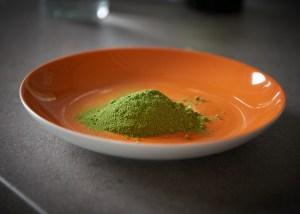 Green powder in a saucer