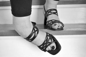 Feet on a stair