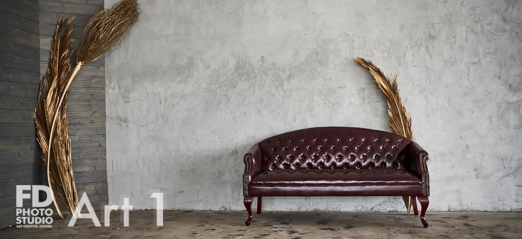 red sofa in a natural light studio