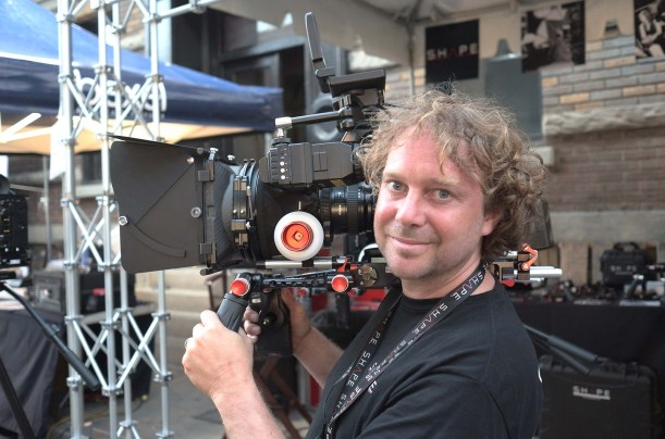 Charles Vallieres of Shape WLB with shoulder rig for Canon C300/500. Press the sprint-loadedred buttons to adjust the handgrip position.