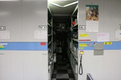 Equipment storage on motorized shelving units