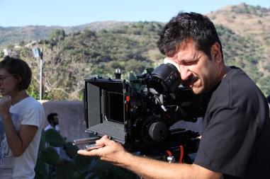 Artistic Director Vincenzo Condorelli (AIC) checking the frame on a set.