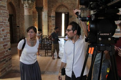 Guest cinematographer Francesca Amitrano (AIC) and student cinematographer Antonio Paolucci (Centro Sperimentale di Cinematografia) discussing the shot in the Abbey of SS Pietro e Paolo d'Agrò.