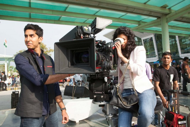 Dev Patel and Tina Desai on the set of THE SECOND BEST EXOTIC MARIGOLD HOTEL. Photo: Laurie Sparham. © Fox Searchlight.