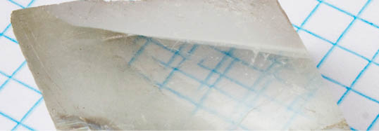 Birefringent crystal showing double refraction. Photo: APN MJM.