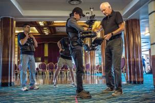 Steadicam inventor, Garrett Brown, fine tunes a student's operating form