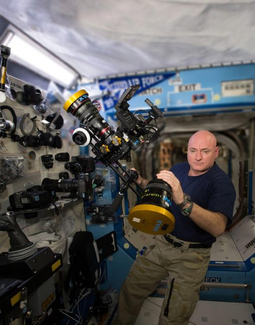 ISS043E276473 - NASA astronaut Scott Kelly preparing IMAX camera equipment & C500 weightless_03 - blurred
