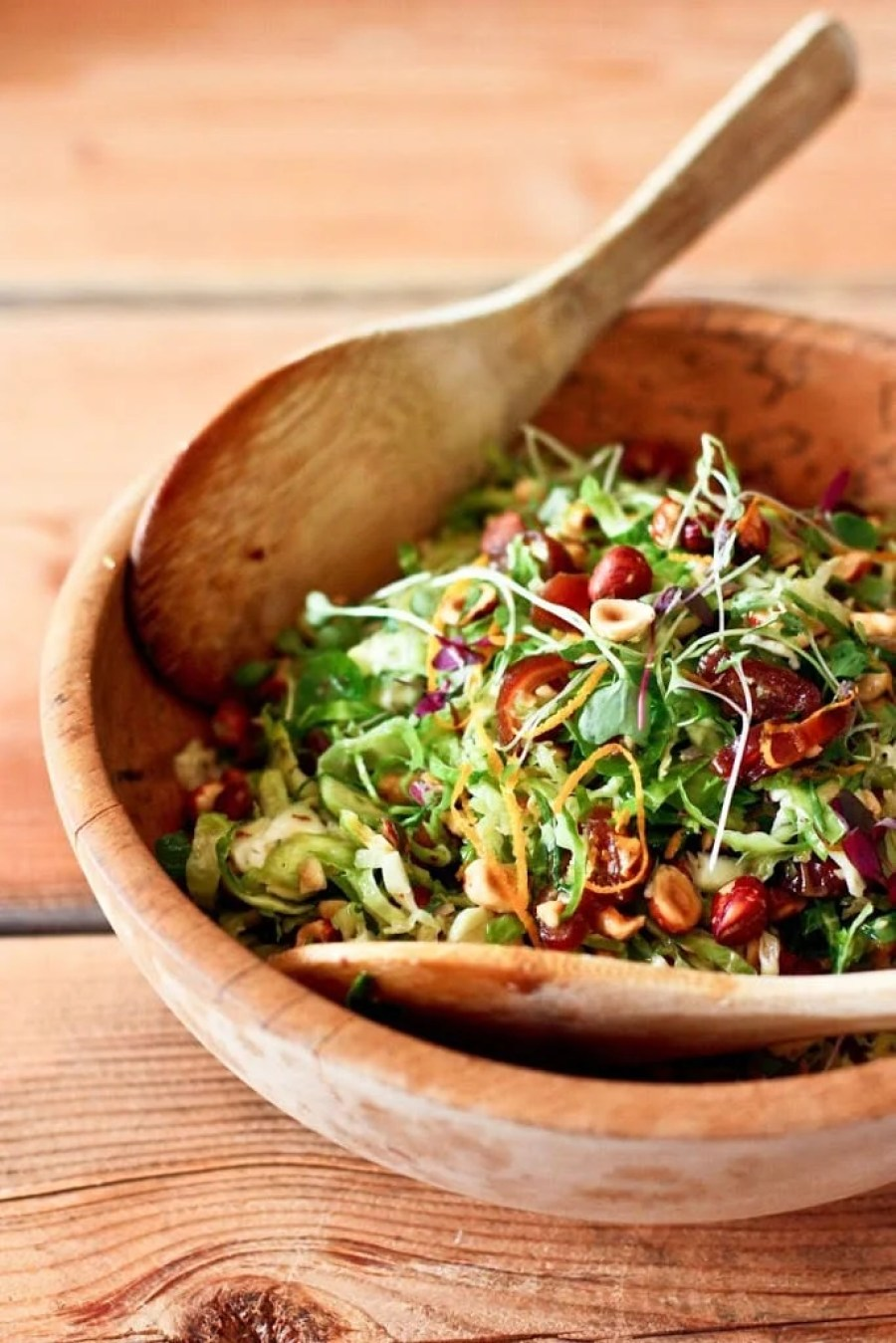 Brussel Sprout Slaw with Hazelnuts and dates+ 15 delicious Thanksgiving SIDE DISHES that will turn your dinner into a feast! | www.feastingathome.com