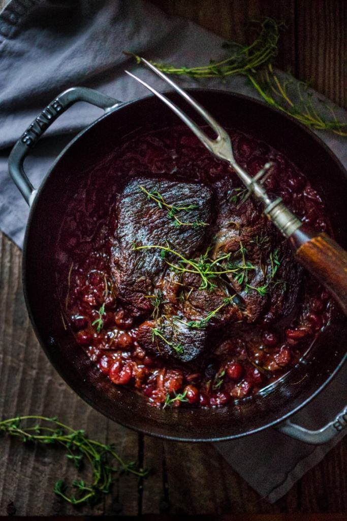 This tasty recipe for Cranberry Pot roast is one of my all time favorites...served it with horseradish mashed potatoes. | www.feastingathome.com