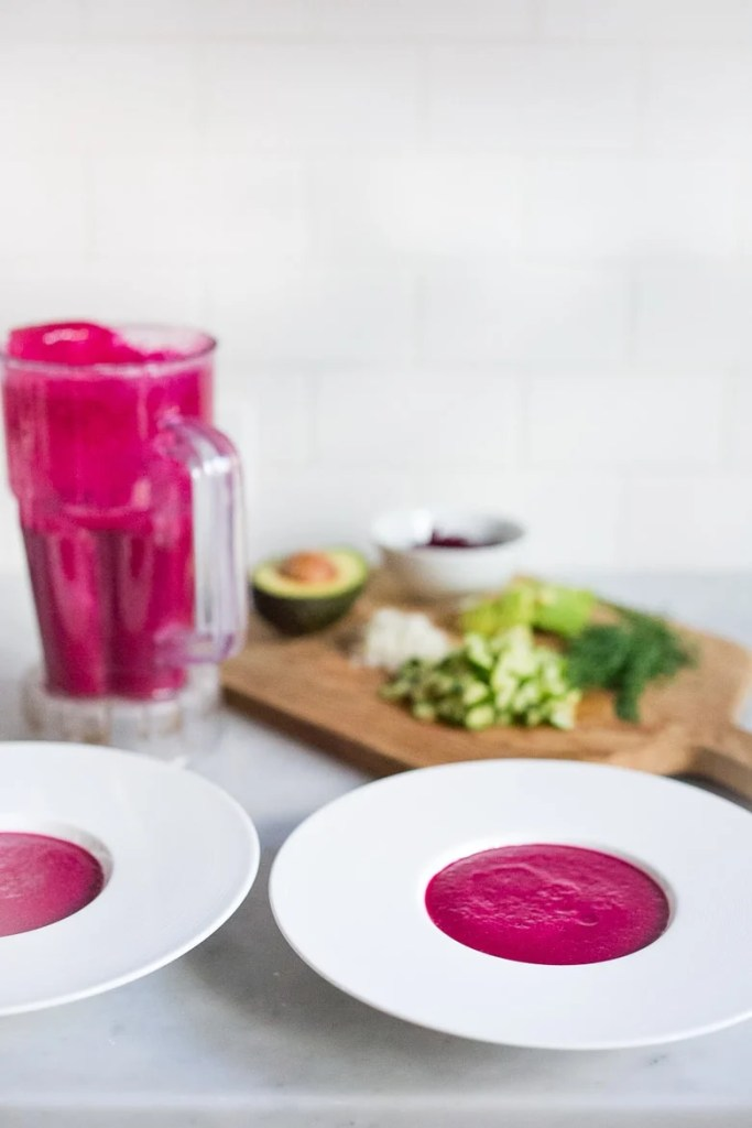 Beet Gazpacho- a luscious chilled beet soup with cucumber, avocado, and fresh dill. Vegan and Gluten free. | www.feastingathome.com