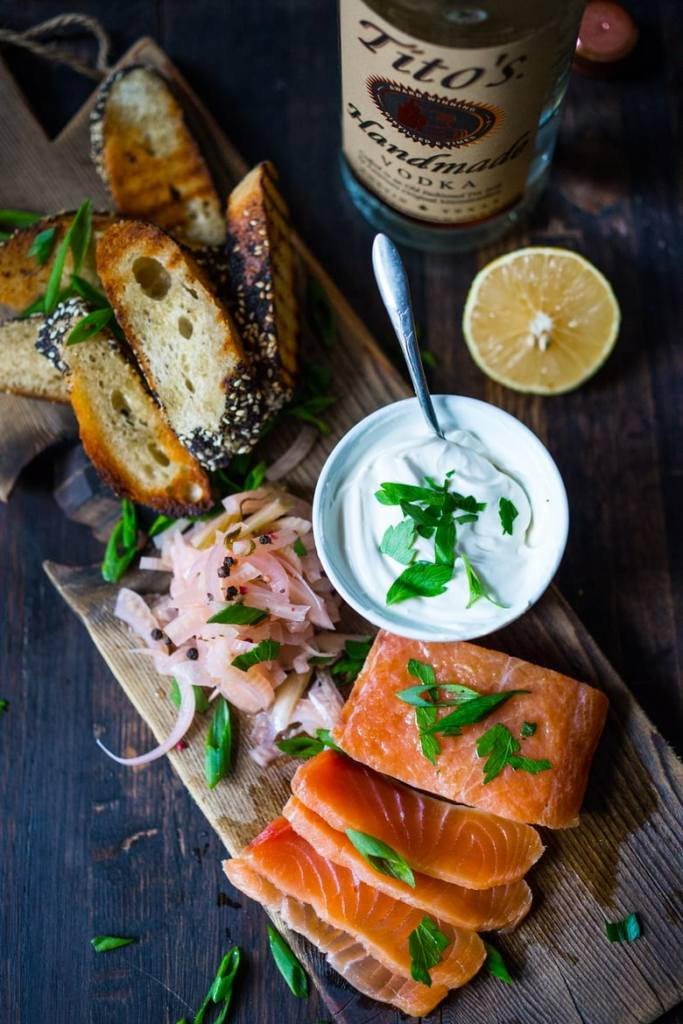 Have you ever made lox at home? It's so easy! This simple recipe for Salt Cured Salmon with rosemary, juniper berries (optional) vodka and lemon zest requires only a few minutes of prep, and then watch as nature takes its course.   www.feastingathome.com
