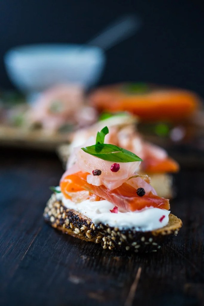 Lox and pickled fennel Bruschetta! This simple recipe for Salt Cured Salmon with rosemary, juniper berries (optional) vodka and lemon zest requires only a few minutes of prep, and then watch as nature takes its course.   www.feastingathome.com