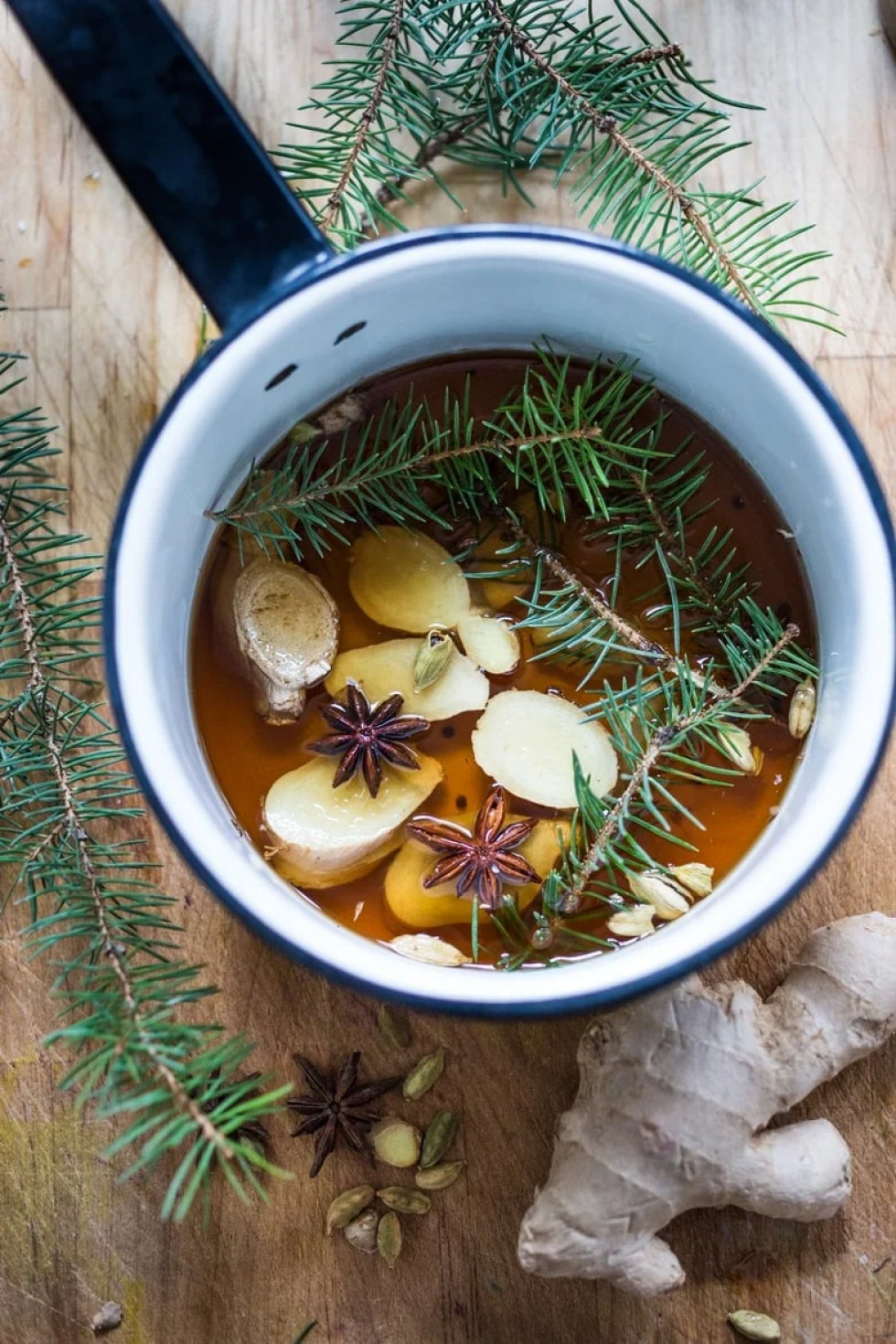 A Long Winter's Nap- A Bourbon cocktail with Maple syrup, ginger, star anise and lemon. A delicious cozy wintery drink! | www.feastingathome.com
