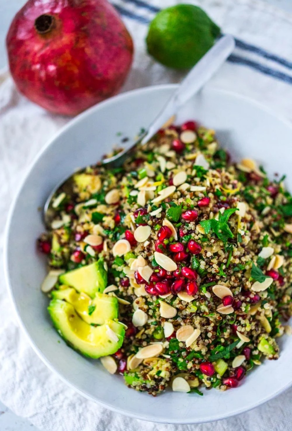 Holiday Crunch Salad with Quinoa, almonds, pomegranate, parsley and mint. | www.feastingathome.com