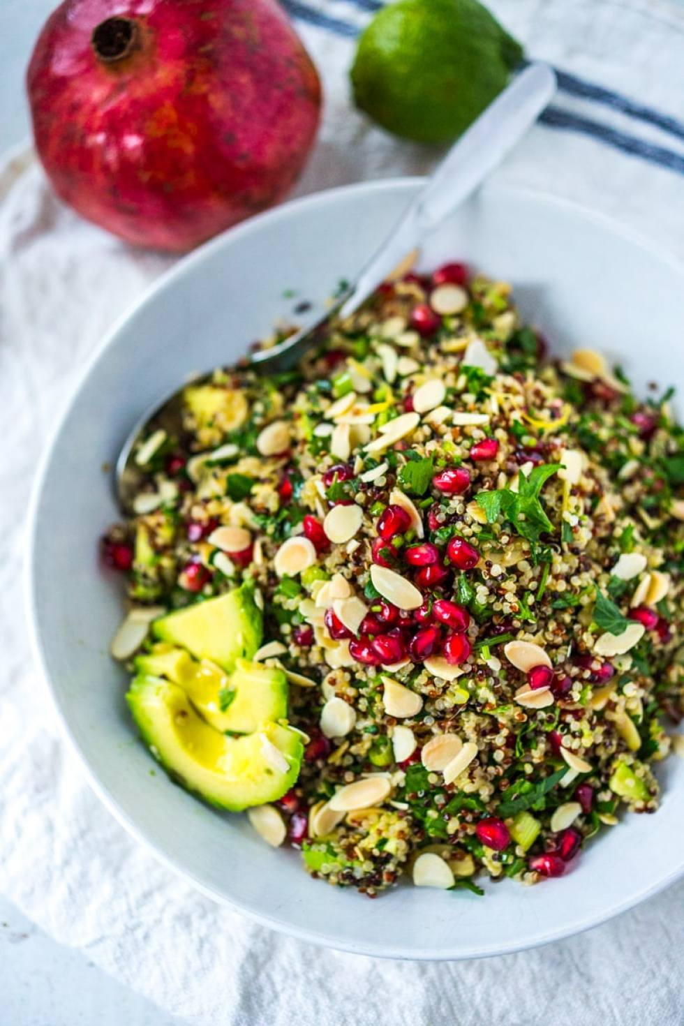 EAT CLEAN with these 20 simple Plant-Based Meals!!!   QUINOA Crunch Salad with almonds, pomegranate, a cleasning vegan and gluten free salad, high in anti-oxcidents and protein!   www.feastingathome.com