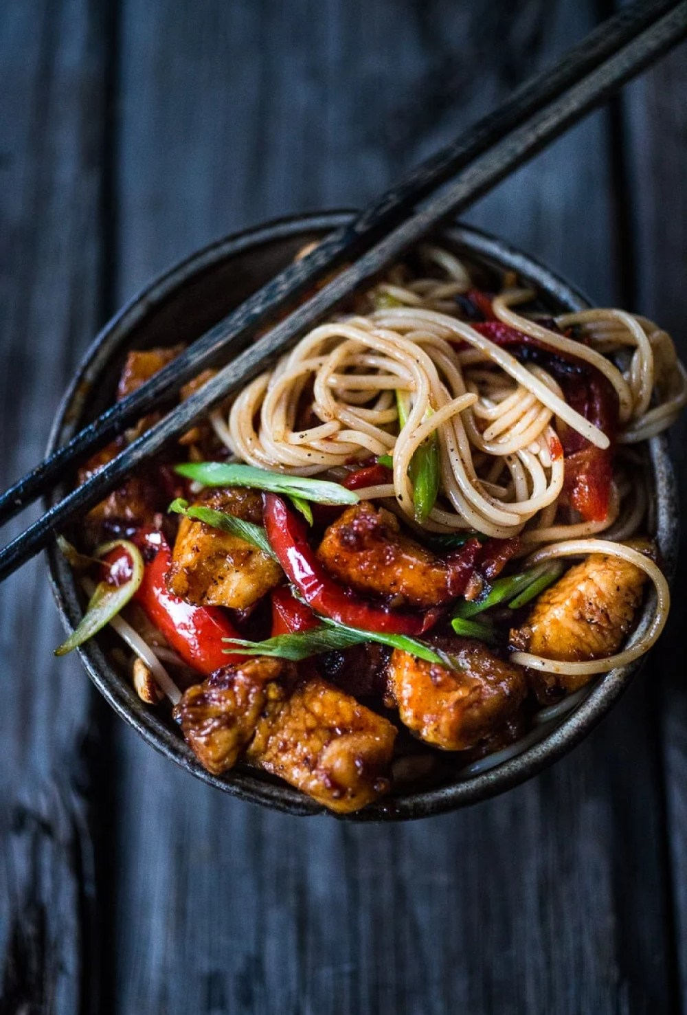 A simple delicious recipe for Kung Pao Noodles that can be made with chicken, tofu, fish, shrimp or veggies, served over noodles with a flavorful Kung Pao Sauce. | www.feasingathome.com