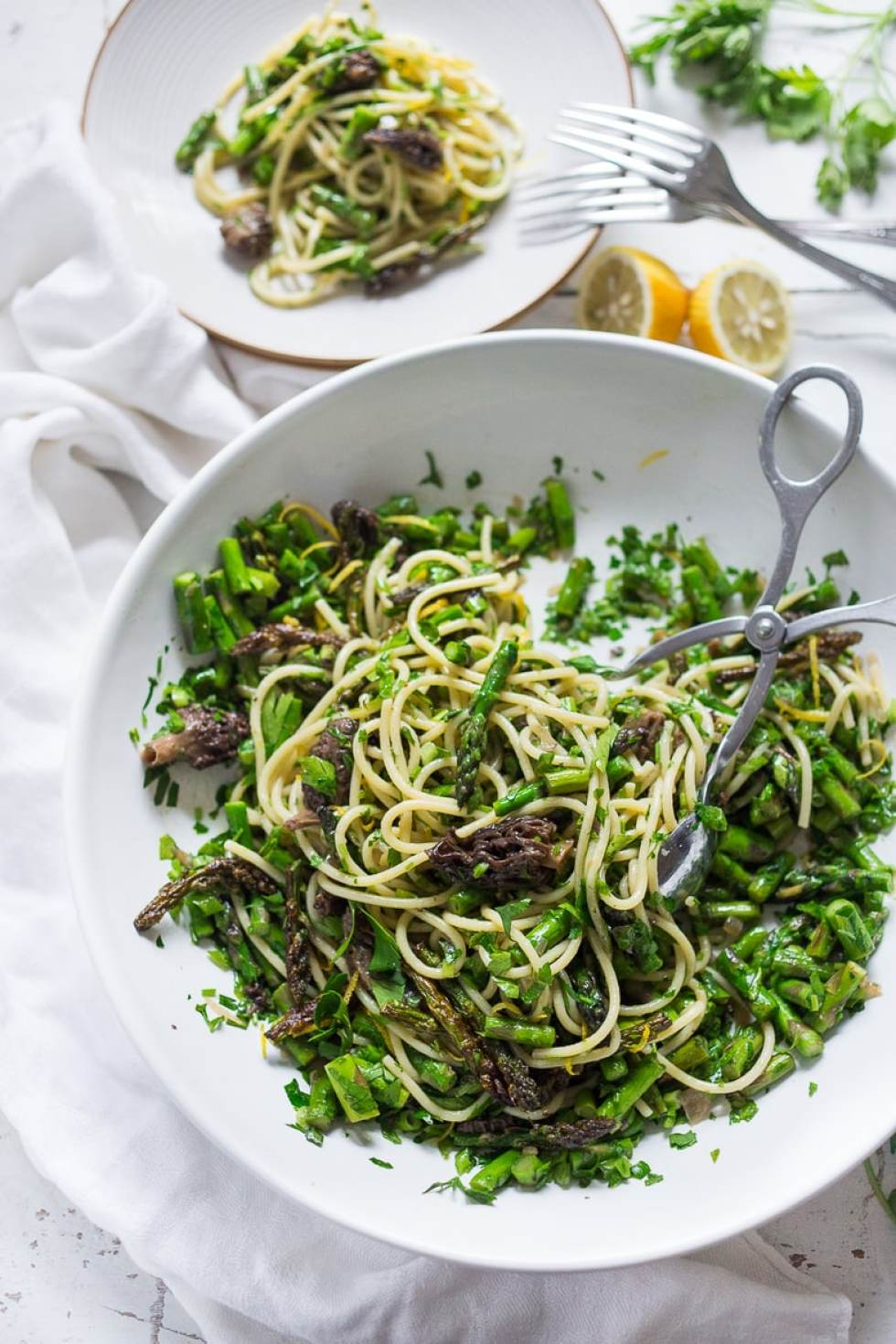 12 Delicious Spring Recipes to celebrate the season! Spring Pasta Salad with asparagus, mushrooms and a zesty lemon- parsley dressing. | www.feastingathome.com