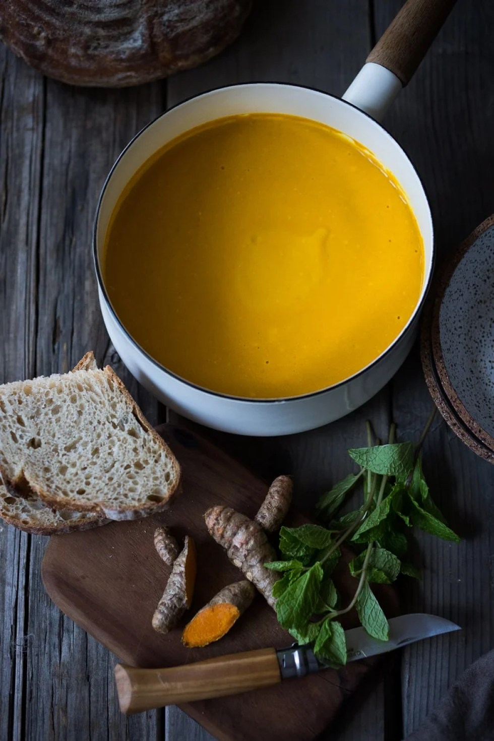 A delicious, healthy recipe for Creamy Carrot Turmeric Soup with Coconut Milk and ginger. Fresh turmeric and mint gives this soup its exotic flavor. Vegan. | www.feastingathome.com
