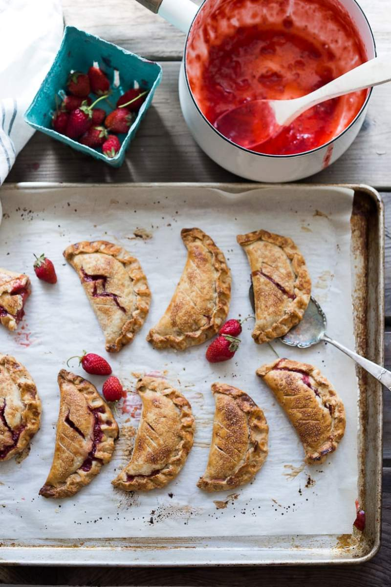 """A simple delicious recipe for Strawberry Turnovers or """"Hand Pies"""" , sweetened with maple syrup. Step by step instructions on mastering the """"double fold"""" which prevent the filling from oozing out while baking. 