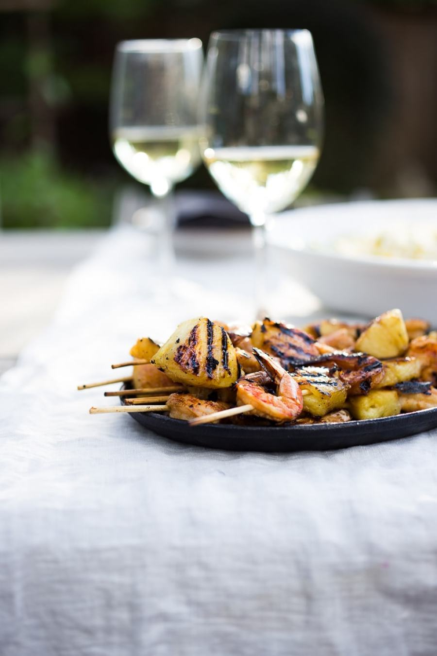 Grilled Chipotle Shrimp and Pineapple Skewers-Juicy, sweet and tangy pineapple snuggledup with subtlyspicy smokey shrimp, so good!!! Servedwith Jicama Mango Slaw!+ 15 Summer Grilling Recipes! | www.feastingathome.com