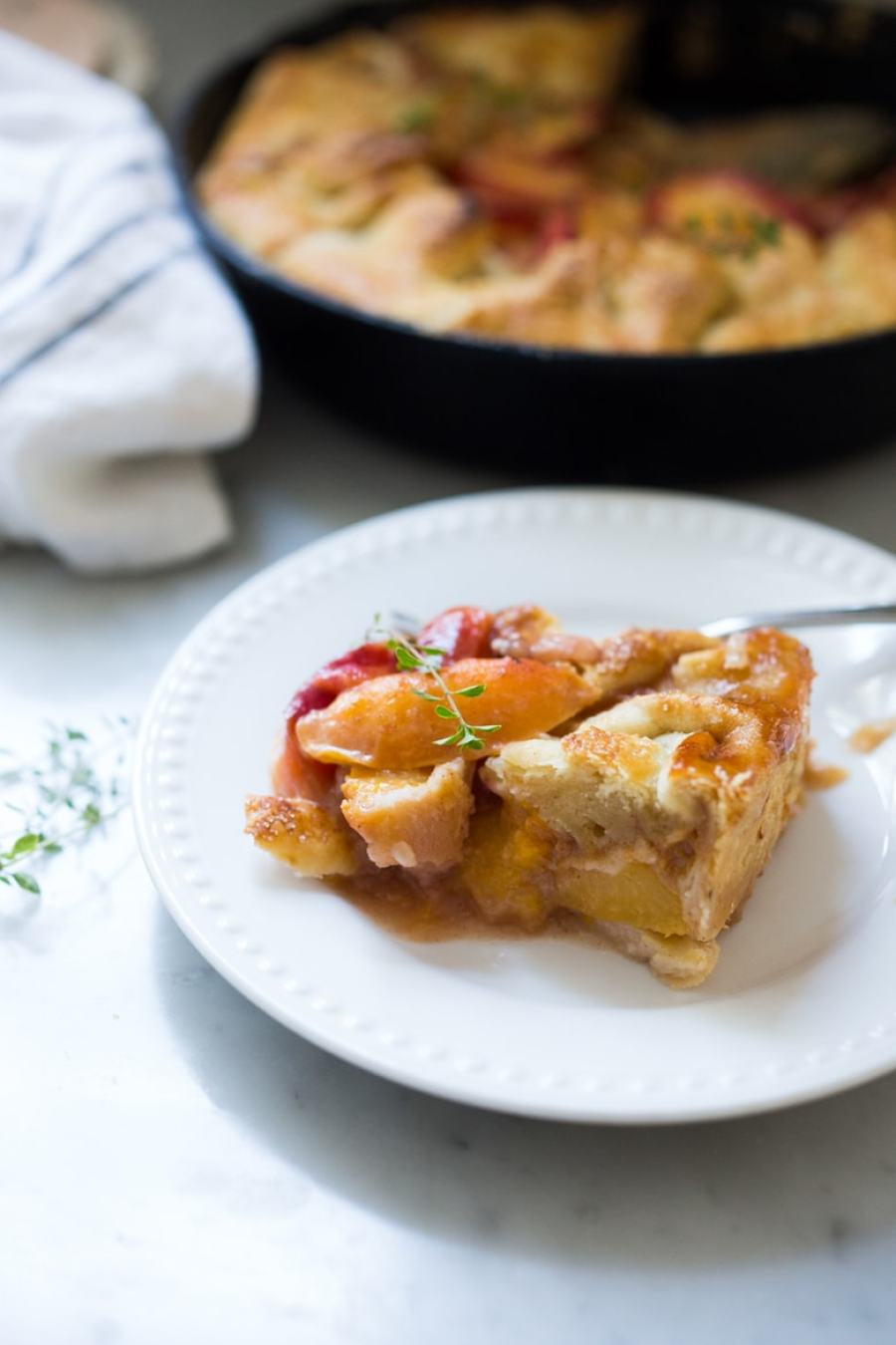An old fashioned, Farm Style Peach Skillet Pie-- a very simple, easy and fast recipe that comes out perfect every time! | www.feastingathome.com