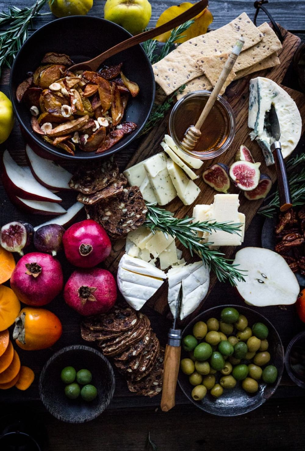 Simplify your holiday gatherings with this Thanksgiving Cheese Board w/ Honey Roasted Quince- an easy guide on how to create a simple, elegant cheese board.
