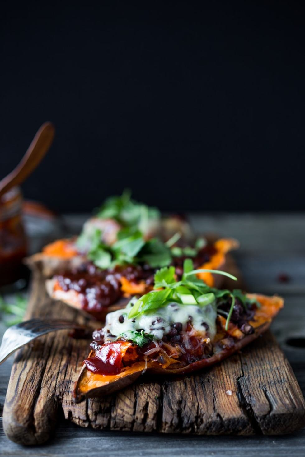 Skinny BBQ Chicken (or Black Bean ) Stuffed Sweet Potato- keep with vegan with black beans and avocado, or add chicken and melty cheese, and top with cilantro. Either way a win!! #glutenfree #vegan | www.feastingathome.com