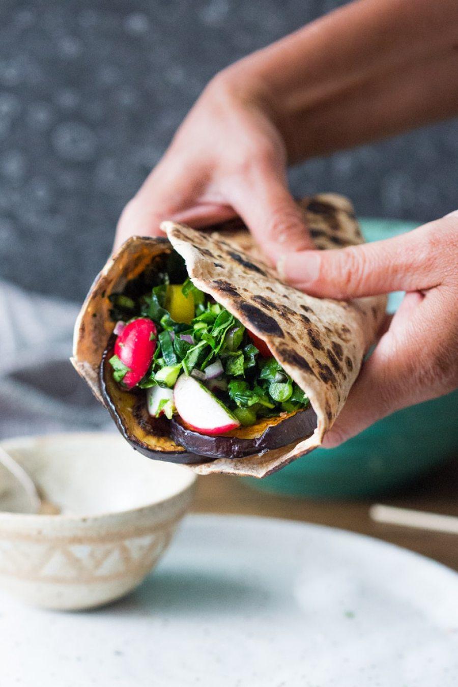 Middle Eastern Eggplant Wrap with a lemony Kale Parsley Mint Slaw with Creamy Tahini Sauce. Keep it vegan or add feta!   www.feastingathome.com