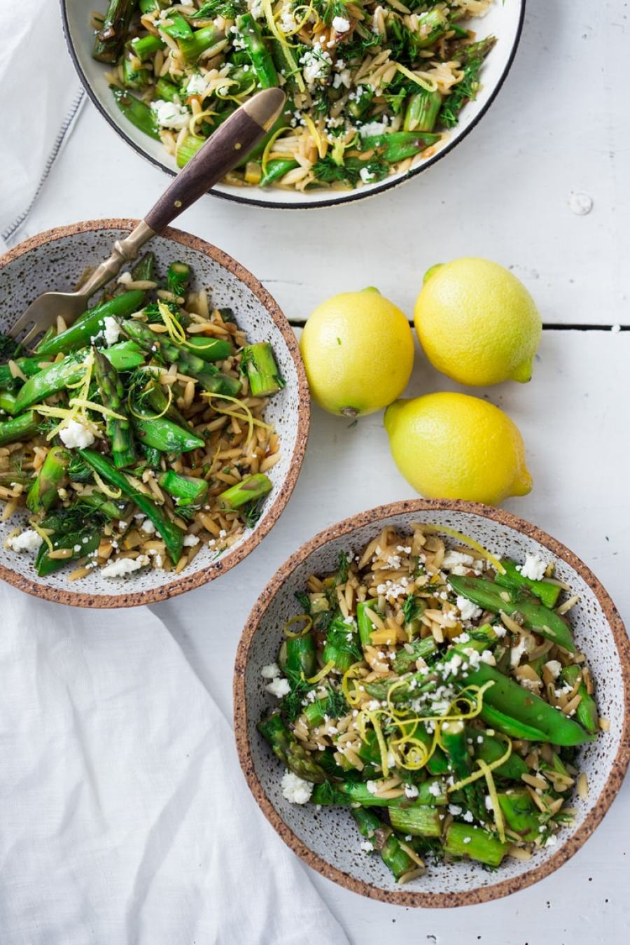 12 Delicious Spring Recipes to celebrate the season! Spring Orzo Pasta with Asparagus, lemon and dill. Keep it vegan or add feta! | www.featingathome.com