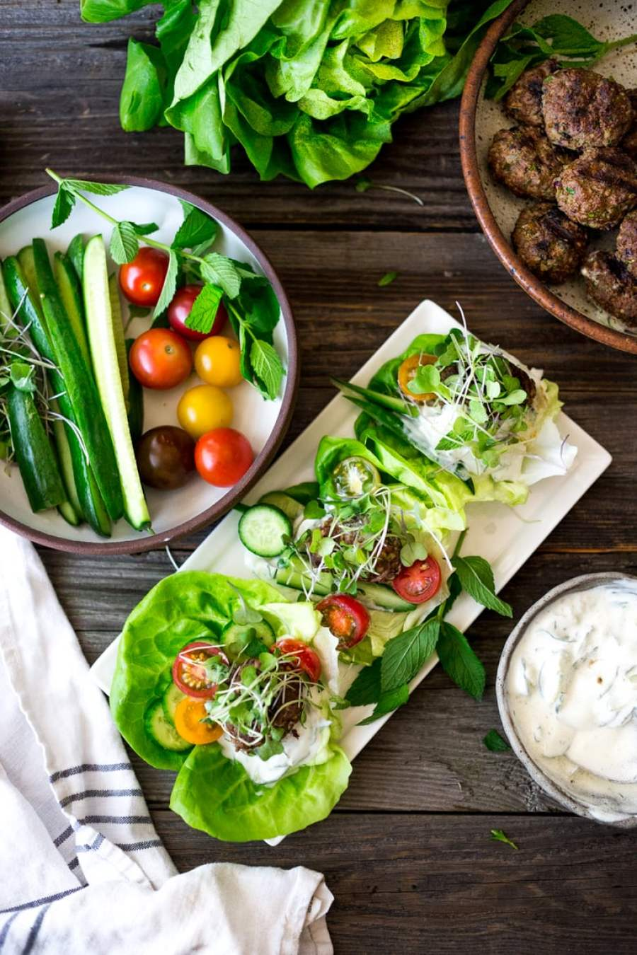 Grilled Lamb Kofta Wraps are light and delicious, and BURSTING with Middle Eastern Flavor! Served with Tzatziki, these are low carb and high in protein. | www.feastingathome.com