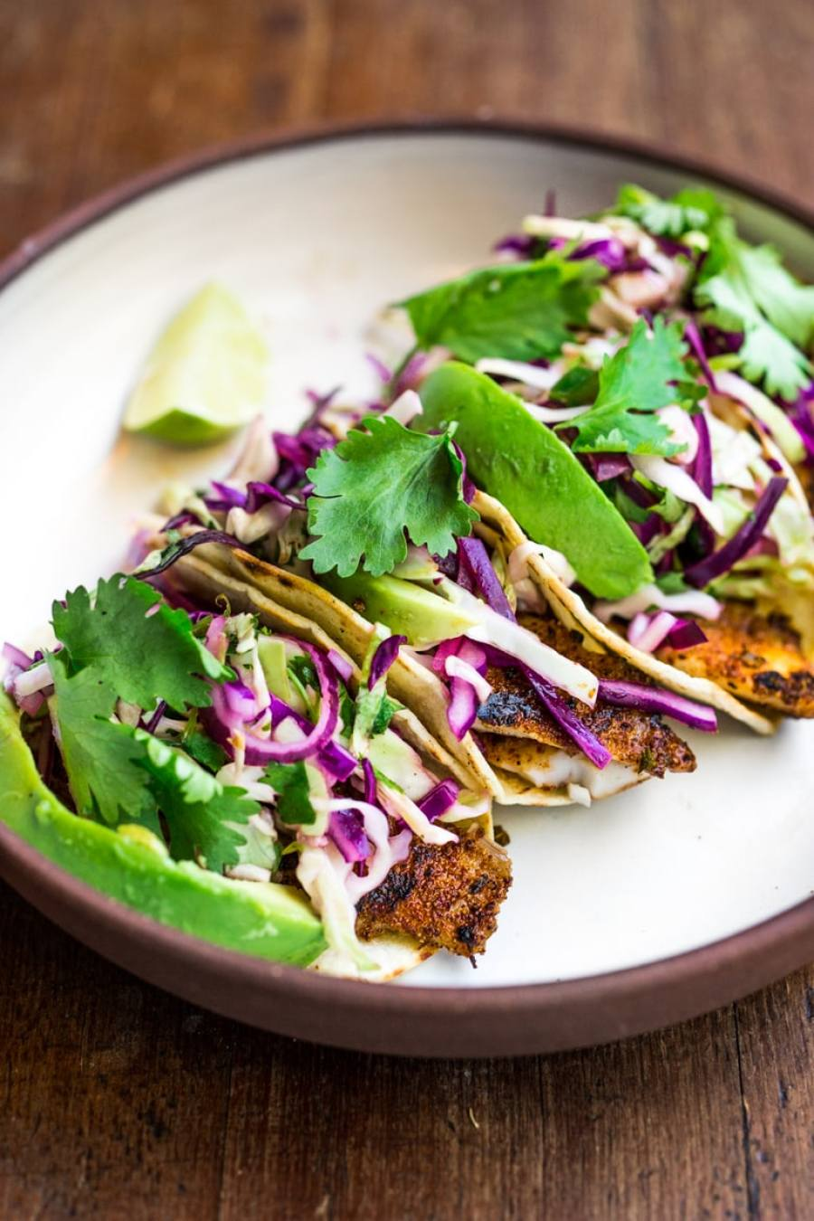 Quick grilled fish tacos w cilantro lime cabbage slaw for Fish tacos with coleslaw