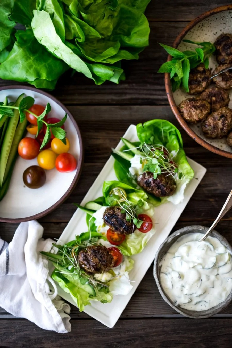 Grilled Lamb Kofta Wraps are light and delicious, bursting with Middle Eastern Flavor! Served with Tzatziki, these are low carb and high in protein. | www.feastingathome.com