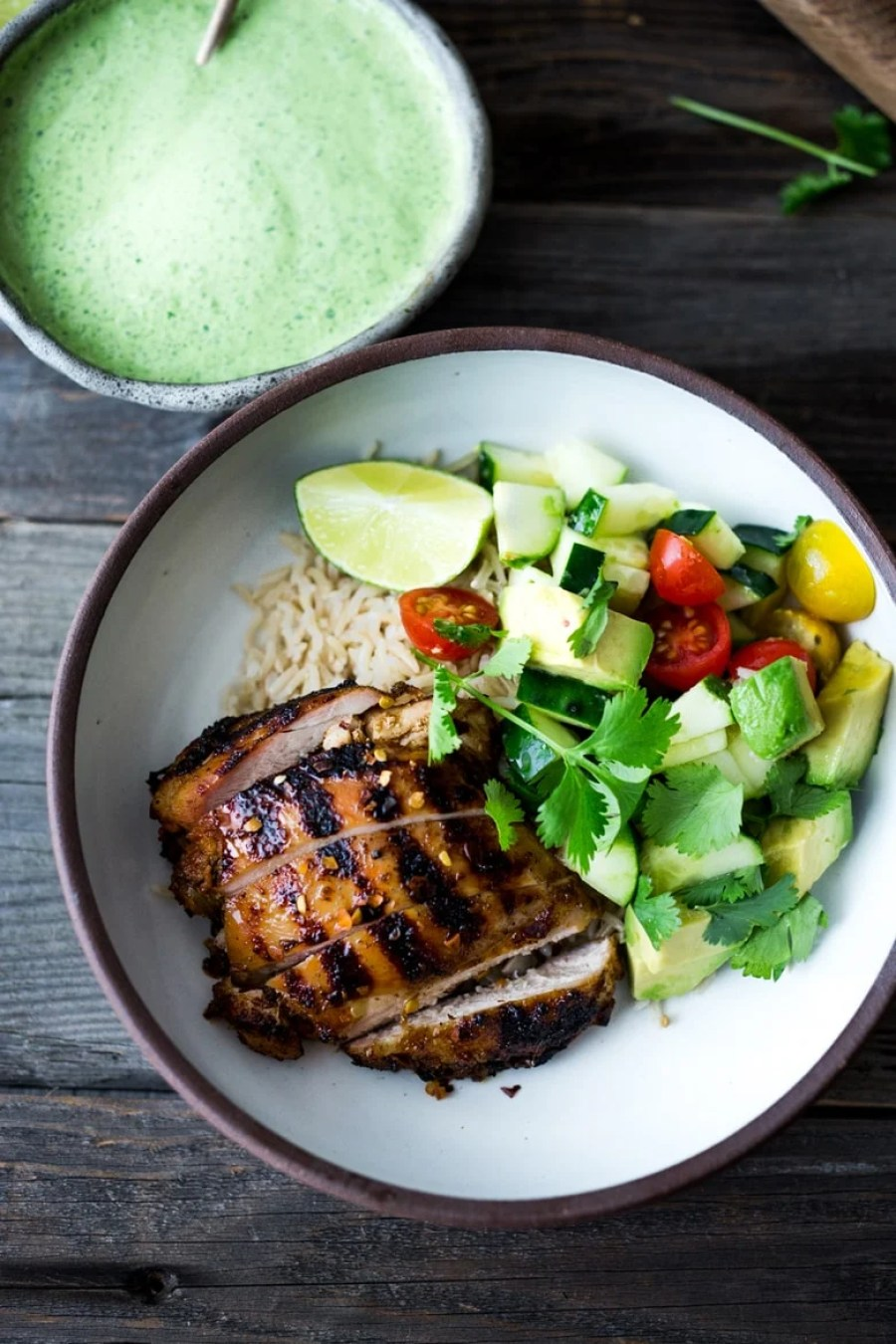 Simple, delicious Grilled Peruvian Chicken with Green Sauce and an Avocado Tomato Cucumber Salad. Can be made in 40 minutes- perfect for weeknights!